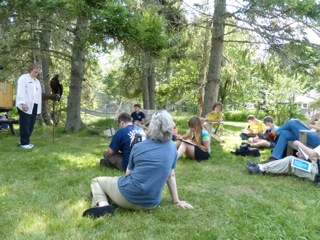 Campers enjoy sketching, photographing, recording, and painting live birds at Arts of Birding, 2013